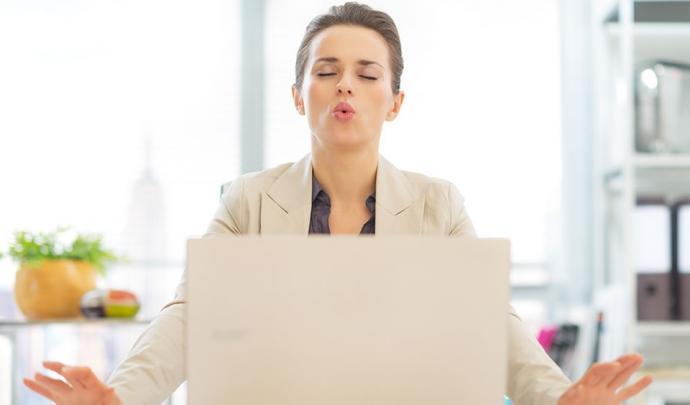 Lady meditating computer